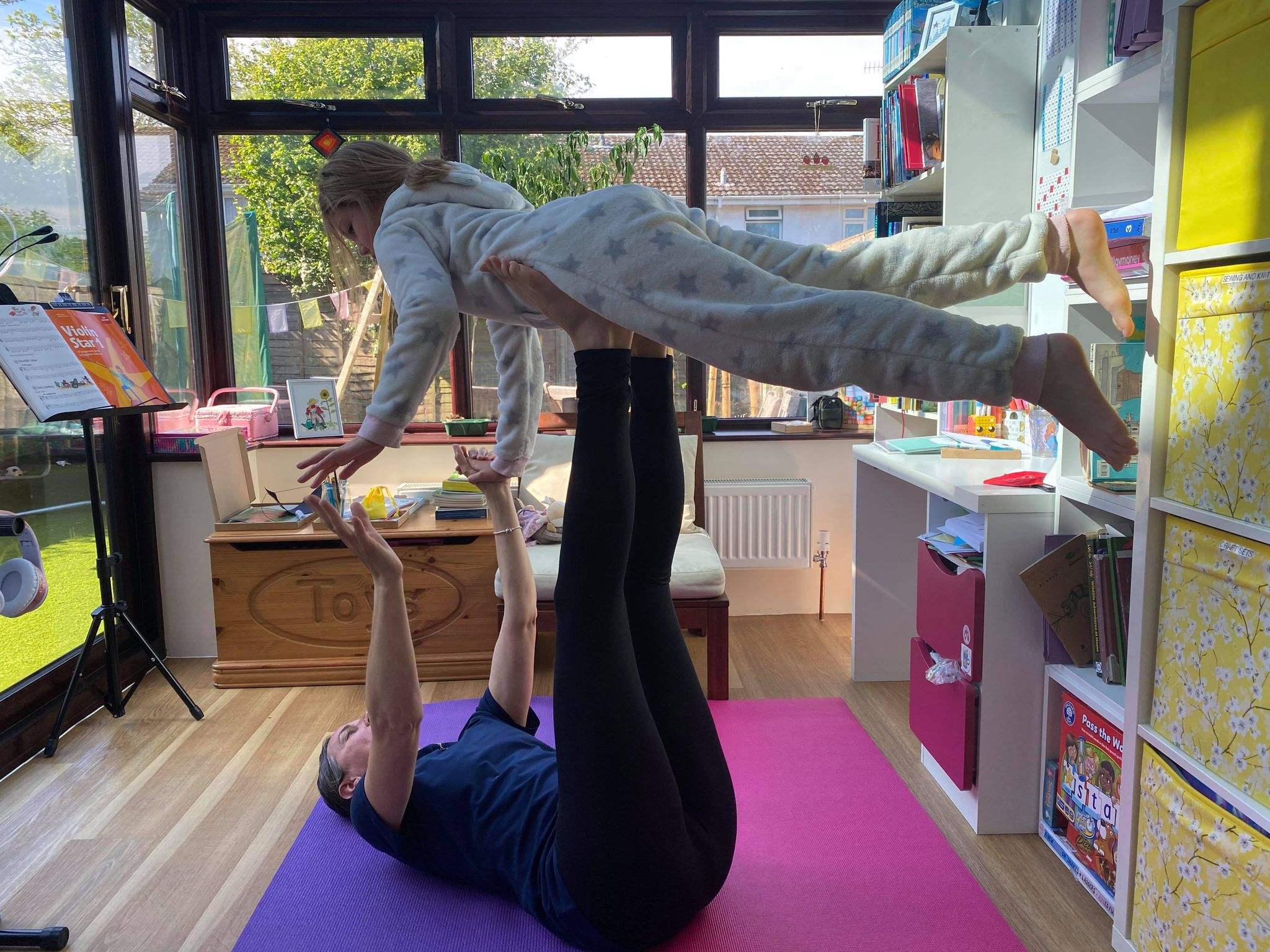 Kat and Bella from Sparkle Yoga pose
